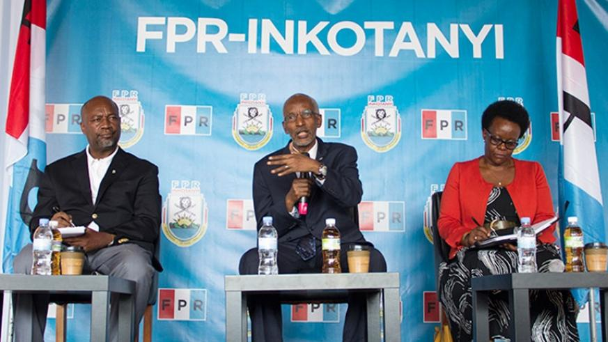 Rwanda Patriotic Front (RPF-Inkotanyi) Secretary-General Francois Ngarambe (C) addresses the media as party commissioner Wellars Gasamagera, who will be the media relations officer....
