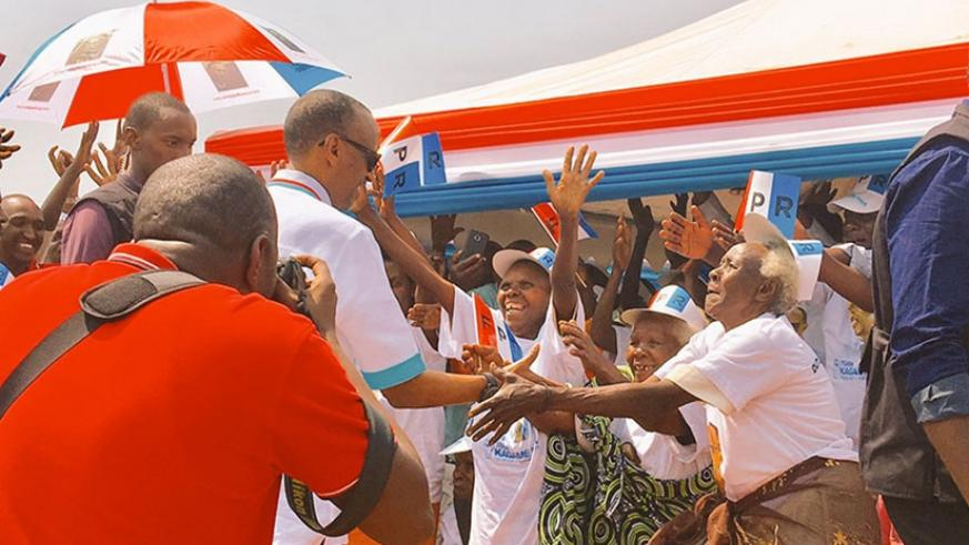 RPF flag-bearer, Paul Kagame greets supporters on his arrival at his first campaign rally that was held in Ruhango district earlier today. (Courtesy photo)
