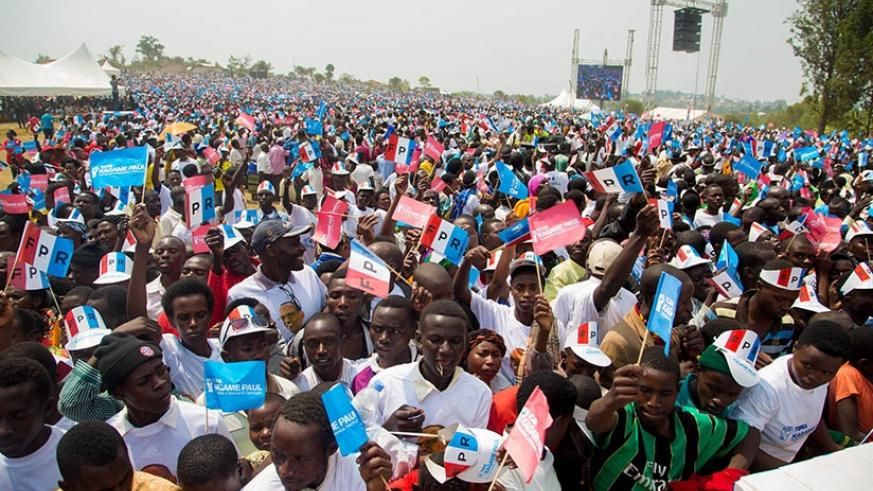 Thousands of RPF members arrive early morning yesterday at Nyanza district site waiting their candidate Paul Kagame to arrive. Faustin Niyigena