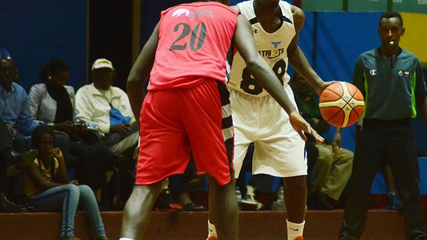 Team captain Aristide Mugabe, right, led Patriots to a 83-77 win over REG to level the playoff finals series at 1-1 on Saturday evening. Game 3 is set for Friday. / Sam Ngendahimana