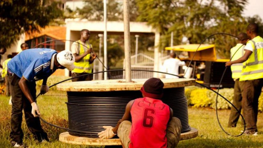 Workers installing cyber optic cables at Kimihurura in Kigali. / File
