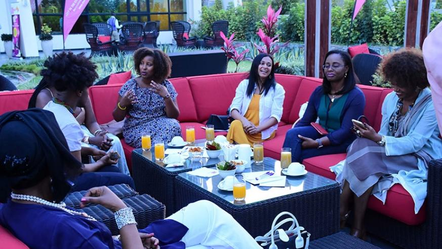 Some of the participants discuss during the 'Conversations at High Tea' forum. / Courtesy.