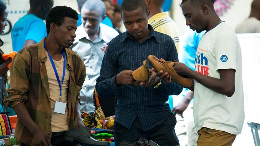 Some of the youths who attended the fifth YouthConnekt look at locally made shoes at an expo last year. File.