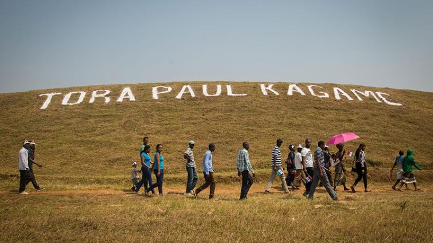 A montage asking people to vote for RPF candidate Paul Kagame on a hill in Huye. Faustin Niyigena.