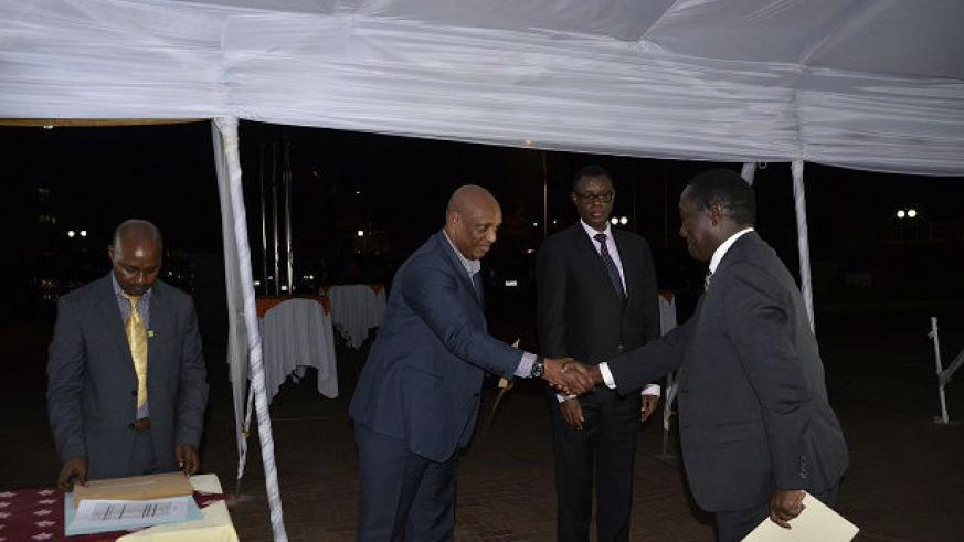 Lt Gen Karenzi Karake is greeted by Chief of Defence Staff Gen Patrick Nyamvumba during the ceremony. / Courtesy