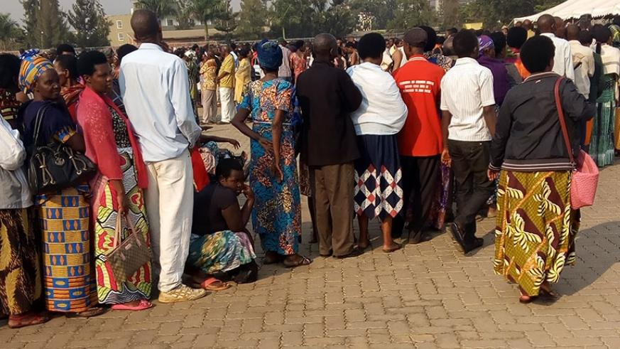 People wait to be screened and vaccinated in Remera during the recently concluded campaign. Steven Muvunyi.
