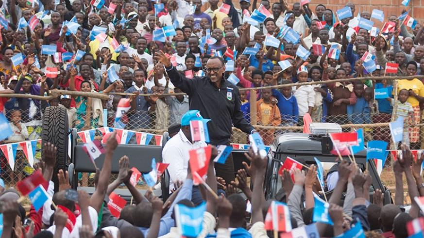 RPF-Inkotanyi Presidential candidate Paul Kagame waves to crowds at a rally in Muhanga District  yesterday. Village Urugwiro.