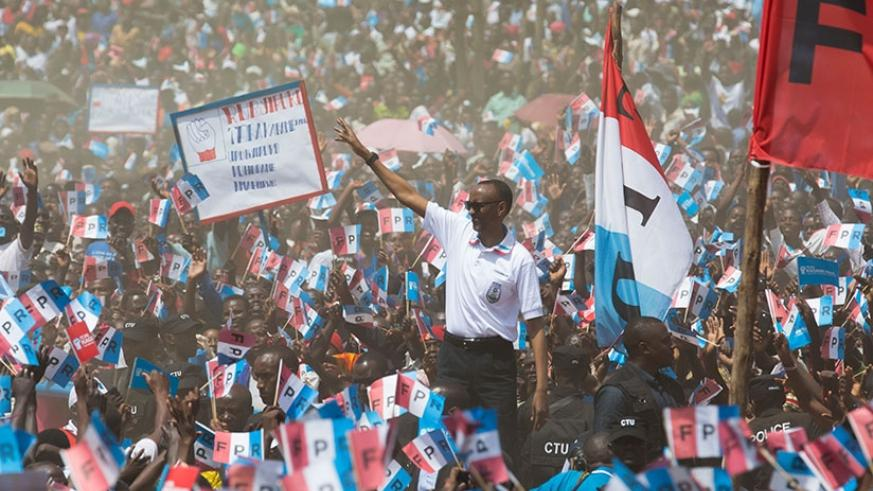 RPF-Inkotanyi candidate Kagame waves to supporters in Bugesera District yesterday. Courtesy