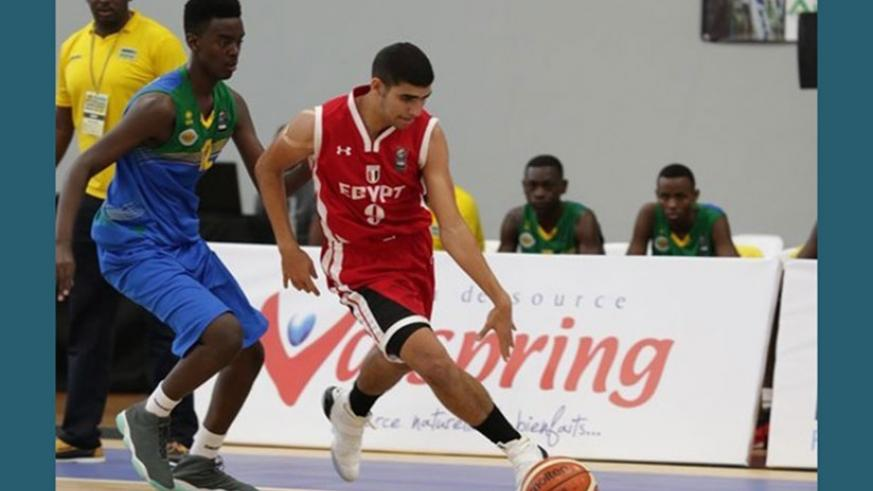 Rwanda's point guard Steff Mucyo Rukundo tries to put a challenge on an Egyptian player during the first round game (Courtesy)