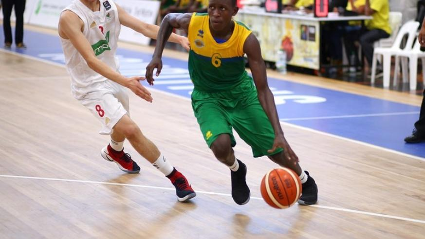 Rwanda's highly rated shooting guard Thierry Nkundwa dribbles past an Algerian player during the last group stage on Thursday in which he dropped a game high 16 points (courtesy)