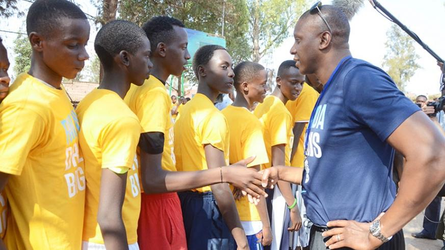 Toronto Raptors general manager a and founder of Giants of Africa, Masai Ujiri talking to some younger talents during the  first training camp in Rwanda in 2015.  Sam Ngendahimana.