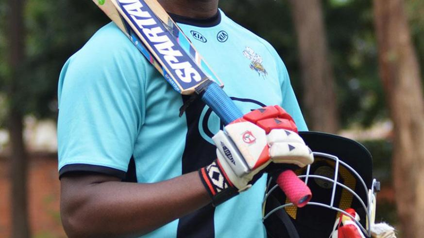 Eric Dusingizimana poses for a photo after training at Kicukiro Cricket oval. / Sam Ngendahimana