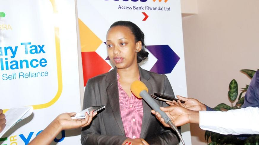 Gloria Asiimwe Bwiza, the Head of Personal and Business Banking in Access Bank speaking to Journalists.