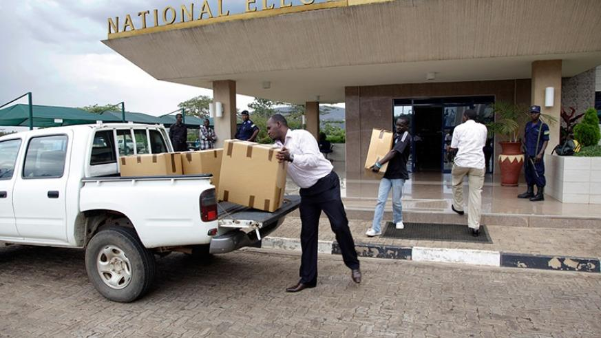 NEC staffers load voters kits on a truck during the 2013 elections. File.