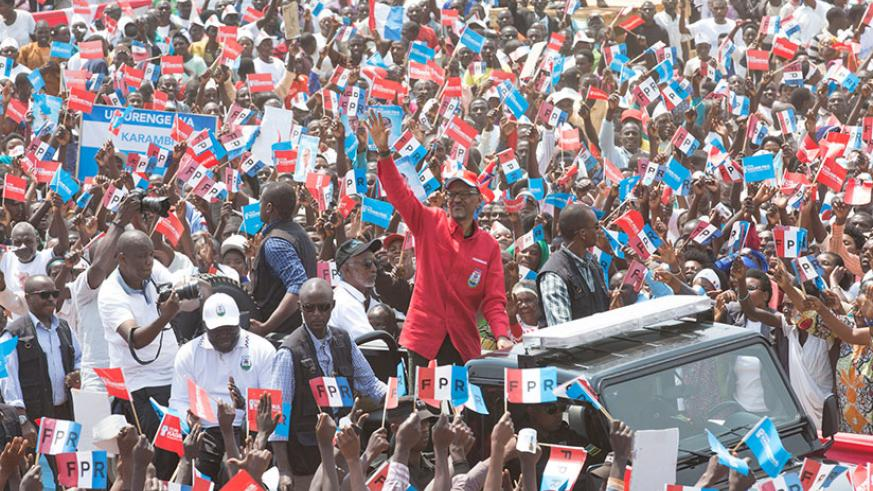 Kagame waves to thousands of supporters in Nyamasheke District where he held his last campaign rally in the Western Province yesterday. / Courtesy