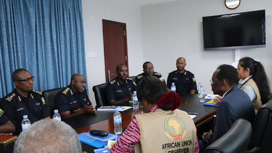 IGP Gasana (second from left, background), flanked by other senior Police officers, speaks during the meeting with the AU observers in Kigali yesterday. Courtesy.