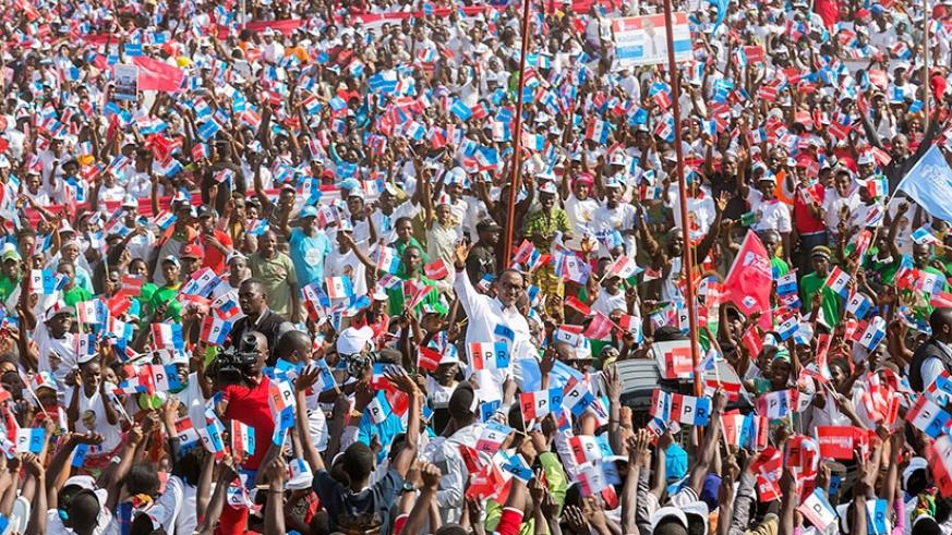 RPF-Inkotanyi candidate Kagame waves to supporters at his final rally in Gasabo District yesterday. Courtesy.