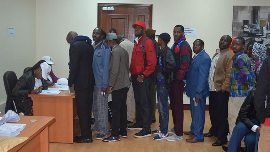 Members of Rwandan community in Nairobi line up as they wait to cast their vote