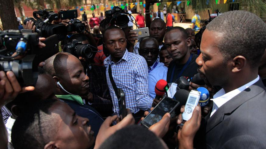 Mpayimana speaks to the media after casting his vote at Camp Kigali Primary School in Nyarugenge. (Sam Ngendahimana)