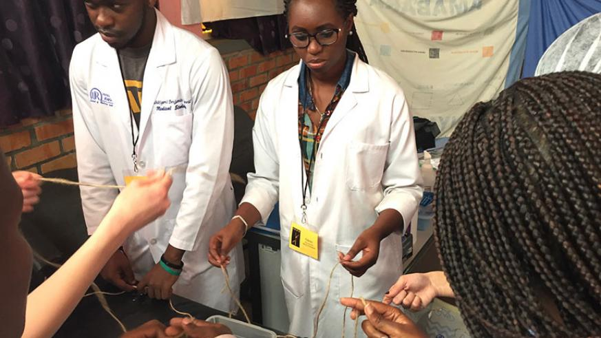 IOWD staff train Rwandan medical students how to carry out reconstructive surgery on fistula patients.