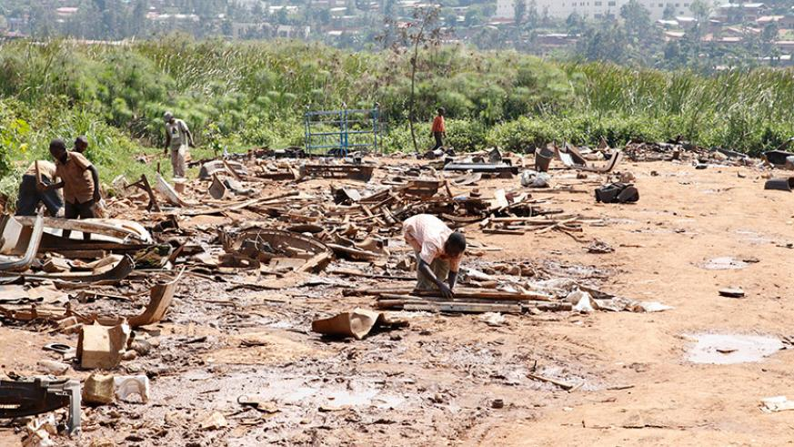 Residents are evacuated from Nyabugogo wetland. Rwanda Environment Management Authority has warned wetland encroachers that the law will catch up with them. / Timothy Kisambira