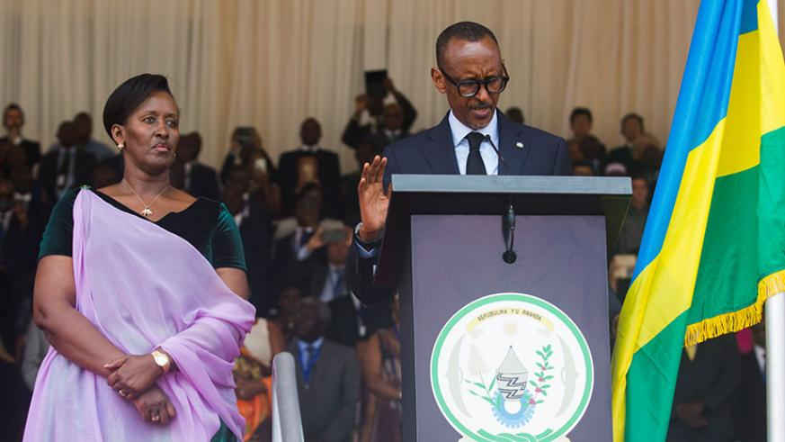 President Kagame takes the presidential oath in the company of First Lady Jeannette Kagame (left) at Amahoro National Stadium in the capital Kigali on Friday, August 18. The inaugu....