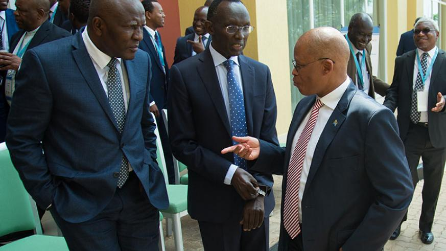 Chief Justices Sam Rugege of Rwanda (C), Abdulai Charm of Sierra Leone (L), and Mogoeng Mogoeng of South Africa chat after the opening session of a three-day continental conference....