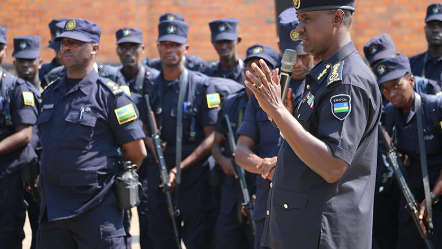 DIGP Dan Munyuza addressing officers during a pre-deployment briefing. / Courtesy