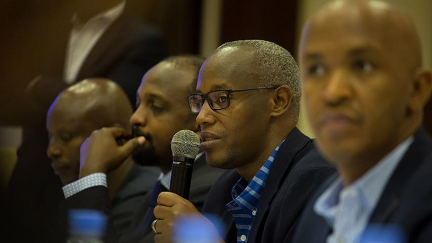 PSF's Ruzibiza speaks during the meeting in Kigali. Timothy Kisambira.