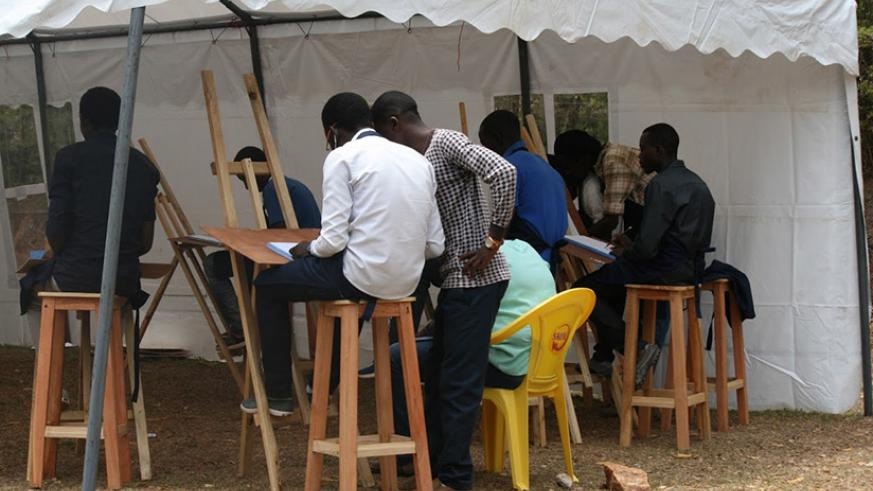 Students of the graphic arts going through practical lessons. / Courtesy