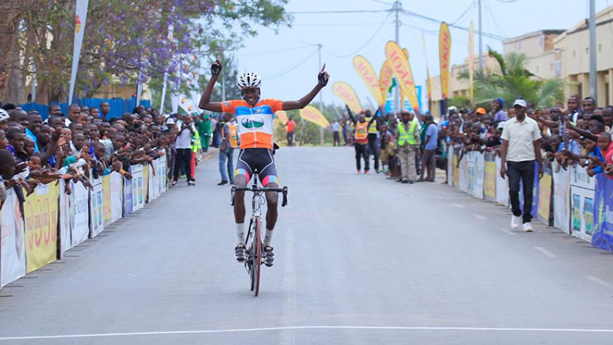 Cycling Club for All rider Mathieu Twizerana celebrates his solo finish in Central Challenge race on Saturday. / Sam Ngendahimana