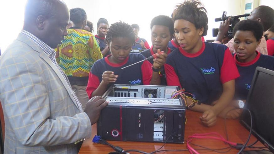 Best performing girls assemble a computer after completing a short course in information technology conducted at Tumba College of Technology.(Photos by Michel Nkurunziza)