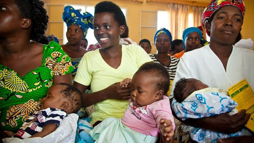 Mothers wait for service at Busanza Health centre in Kanombe. Timothy Kisambira.