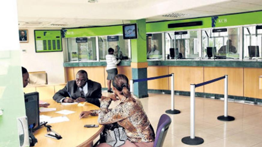 Customers  line up for credit at KCB bank branch in Nyarutarama. File