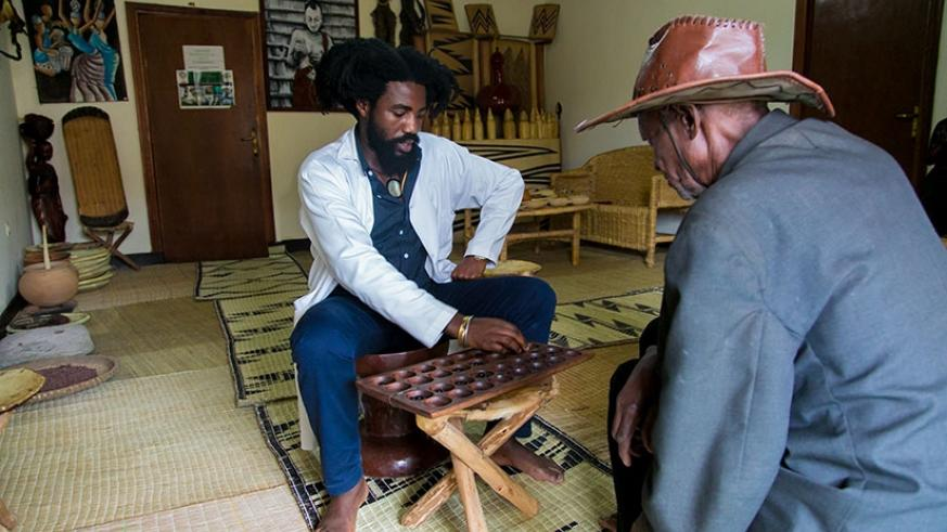 Traditional Rwandan board game is one of the tools used by Rutangarwamaboko to heal his patients. / Faustin Niyigena