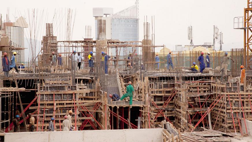 Workers on a construction site in Kigali City. / File photo