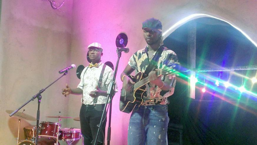 Kenzo (R) and Mani Martin during the video shoot for Afro at Kwetu Residence Inn in Kagugu. / Moses Opobo