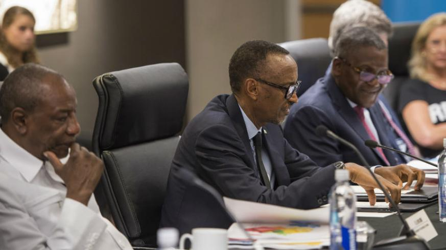 President Kagame addresses the 5th SDG Center for Africa Board Meeting as President Alpha Conde of Guinea (left) and Nigerian business magnet Aliko Dangote, the initiative co-chair....