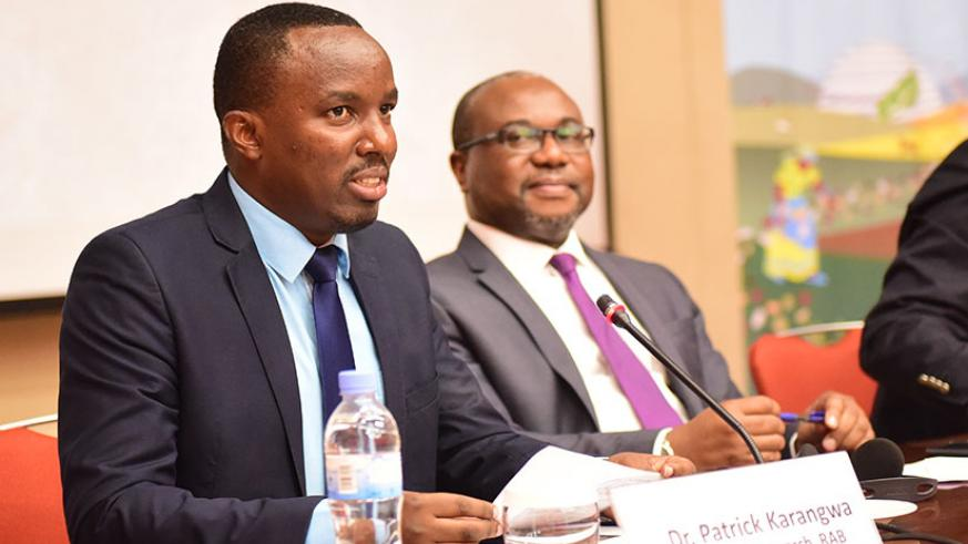 Dr Patrick Karangwa, the director of research at Rwanda Agriculture Board (L), speaks during the African Union Regional Workshop on the Implementation of the International Treaty o....