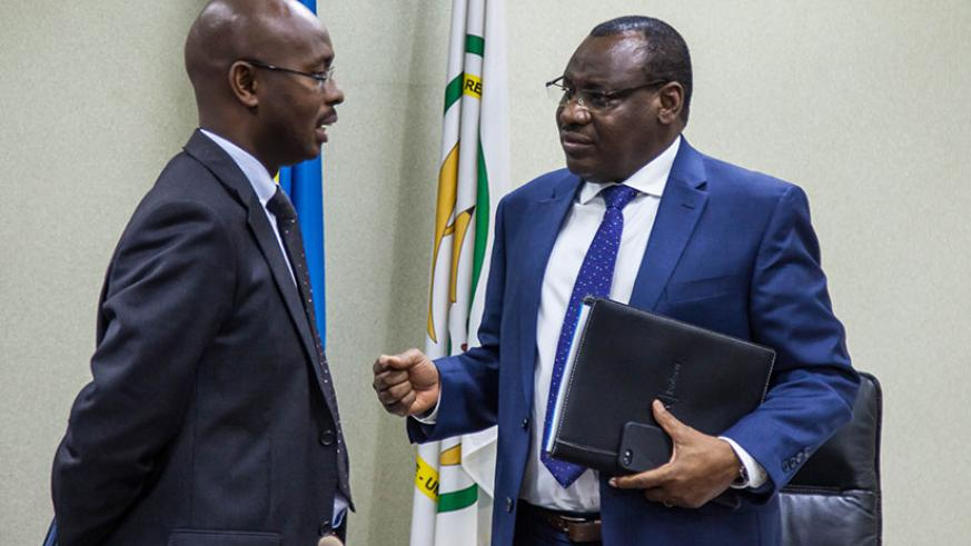 Finance and Economic Planning Minister Claver Gatete (R) chats to Yusuf Murangwa, the DG of the National Institute of Statistics of Rwanda during the presentation of the report on ....