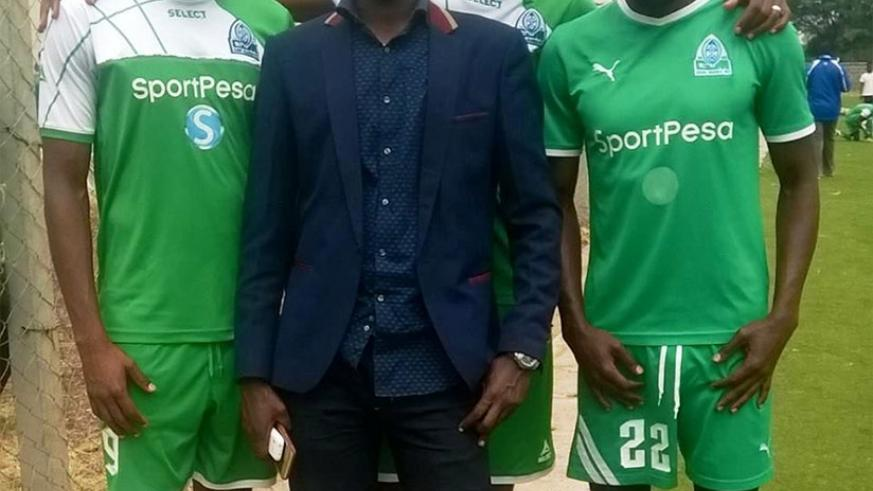 Gakumba pose for a photo with Rwandan players Kagere (left), Tuyisenge (right) and Mugiraneza. He was involved in their moves to Gor Mahia. / Courtesy