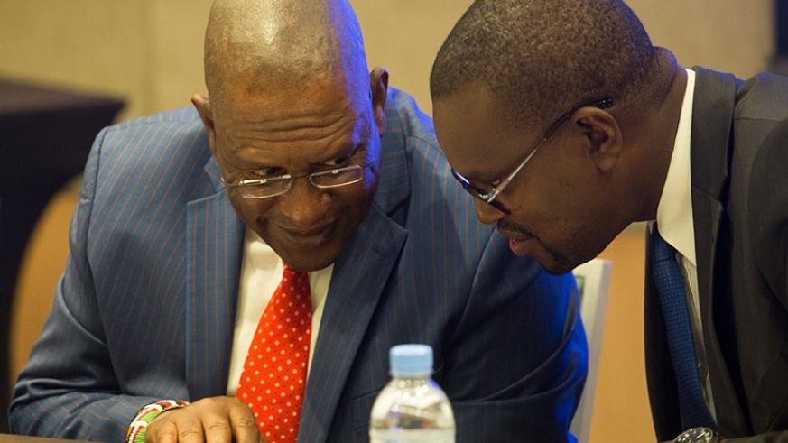 Keriako Tobiko, the director of Public Prosecutions of Kenya (L), chats with his Rwandan counterpart Jean Bosco Mutangana during the 6th annual general meeting of East African Asso....