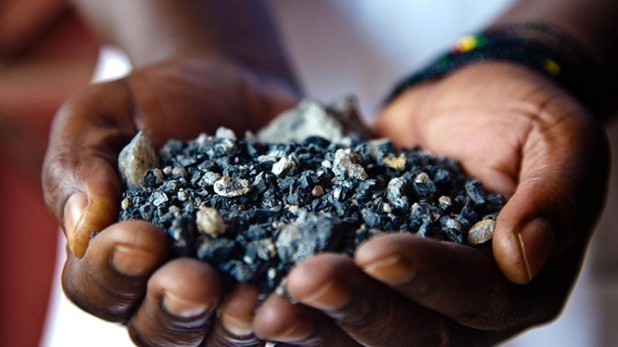 A miner displays minerals at Gatumba Mineral Site. The Chief Executive of Rwanda Mines, Petroleum and Gas Board, Francis Gatare, has said that the Government's recent announcement ....