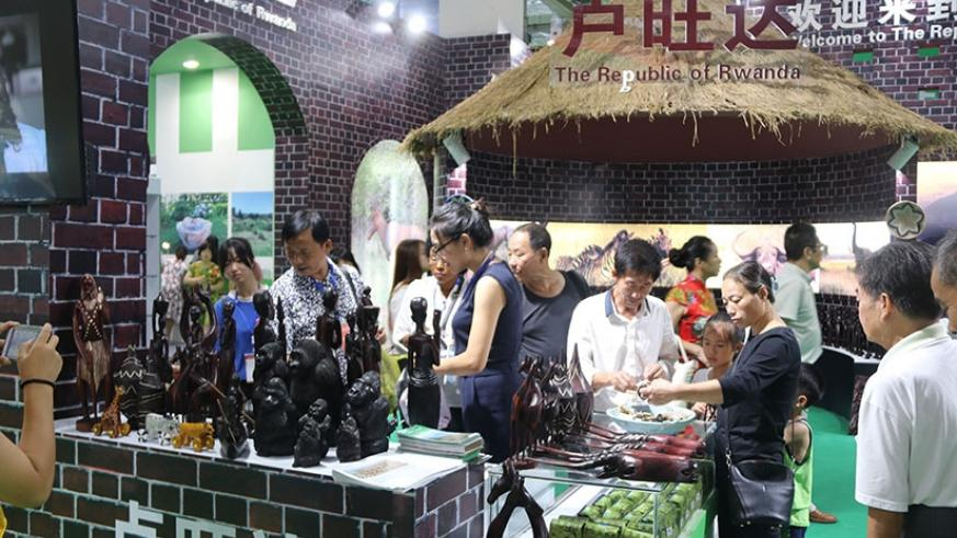 Showgoers admire handicrafts that were exhibited at the expo in South China. / Richard Ruhimbana