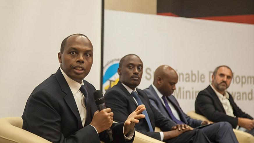 The Chief Executive of Rwanda Mines, Petroleum and Gas Board, Francis Gatare, speaks during the launch of sustainable development of mining in Rwanda as Frank Butera, the executive....