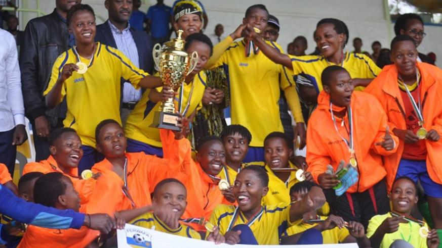 AS Kigali players and officials celebrate after capturing a record-extending 9th Women's football league title on Saturday. Courtesy
