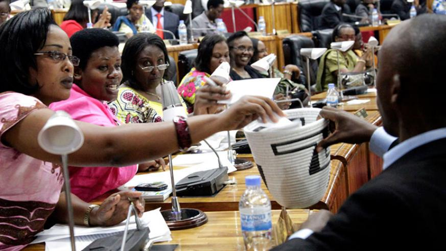 Members of Parliament vote during a past election for the House leaders. / File