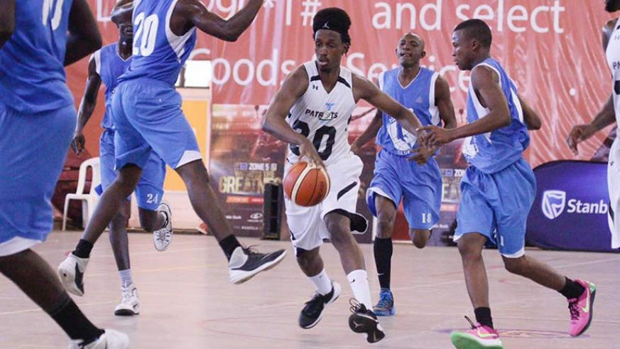 Point-guard Hamza Ruhezamihigo dribbles the ball past ABC players during the just concluded Zone V Club Championships in Kampala. (File)