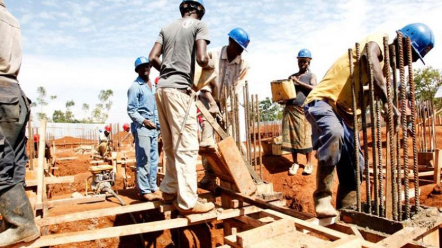 Workers at a construction site in Kigali. Contractors have often been accused of not paying their employees. (File)