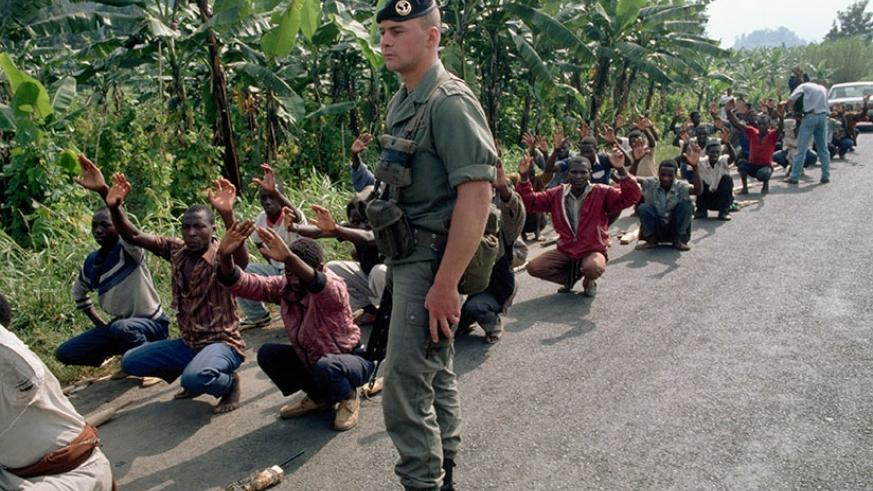 A French soldier supervises the training of Interahamwe militiamen. The Interahamwe killed more than 1 million Tutsi during the Genocide (File)